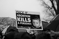 January 23, 2012  (Washington, DC)  Pro-life supporters hold signs during the  annual March For Life and rally held on the National Mall in Washington.   (Photo by Don Baxter/Media Images International)