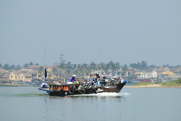 Asia, Vietnam, near Hoi An. Ferry on the Thu Bon river near Hoi An.