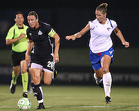 Abby Wambach #20 of the Washington Freedom gets past Maggie Tomecks #5 of the Boston Breakers during a WPS match at Maryland Soccerplex on July 29, in Boyds, Maryland. Freedom won 1-0.