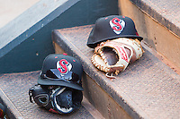 Nashville Sound hat and gloves sit on the dugout steps in a game against the Oklahoma City Dodgers at Chickasaw Bricktown Ballpark on April 15, 2015 in Oklahoma City, Oklahoma. Oklahoma City won 6-5. (William Purnell/Four Seam Images)