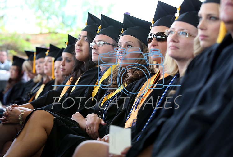 Graduates listen to speeches at the Western Nevada College commencement at the Pony Express Pavilion, in Carson City, Nev., on Monday, May 19, 2014. <br /> Photo by Cathleen Allison/Nevada Photo Source