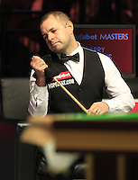 Barry Hawkins checks the tip of his cue during the Dafabet Masters Quarter Final 1 match between Mark Allen and Barry Hawkins at Alexandra Palace, London, England on 14 January 2016. Photo by Liam Smith / PRiME Media Images