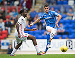 St Johnstone v Inverness Caley Thistle...08.08.15...SPFL..McDiarmid Park, Perth.<br /> Graham Cummins is closed down by Andrea Mutombo<br /> Picture by Graeme Hart.<br /> Copyright Perthshire Picture Agency<br /> Tel: 01738 623350  Mobile: 07990 594431