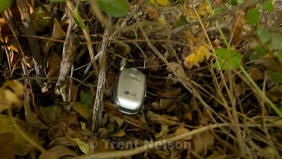 journalist's cel phone hidden in bushes. The Warren Jeffs' trial Friday, Sept. 14, 2007, in St. George, Utah. Jeffs, head of the Fundamentalist Church of Jesus Christ of Latter Day Saints, is charged with two counts of rape as an accomplice for allegedly coercing the marriage and rape of a 14-year-old follower to her 19-year-old cousin in 2001.