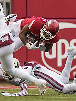 Hawgs Illustrated/BEN GOFF <br /> Cameron Dantzler, Mississippi State defensive back, upends David Williams, Arkansas running back, in the fourth quarter Saturday, Nov. 18, 2017, at Reynolds Razorback Stadium in Fayetteville.