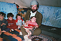Turkey 1989  Mohammed Rashid  with his children under the tent  in the refugee camp of Mardin  Turquie 1989 Mohammed Rashid avec ses enfants sous la tente au camp de refugies de Mardin