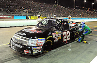 Nov. 13, 2009; Avondale, AZ, USA; NASCAR Camping World Truck Series driver Tim George Jr. pits after crashing during the Lucas Oil 150 at Phoenix International Raceway. Mandatory Credit: Mark J. Rebilas-