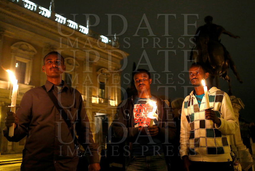 Veglia in memoria dei migranti morti nel naufragio di una nave al largo dell'isola di Lampedusa, in piazza del Campidoglio, Roma, 4 ottobre 2013.<br /> Partecipants attend a vigil in memory of migrants dead after a ship caught fire and sank off the Sicilian island of Lampedusa, southern Italy, at Rome's capitol hill, 4 October 2013.<br /> UPDATE IMAGES PRESS/Riccardo De Luca
