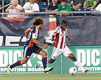 Chivas USA midfielder Miller Bolanos (17) dribbles down the wing. In a Major League Soccer (MLS) match, the New England Revolution tied Chivas USA, 3-3, at Gillette Stadium on August 29, 2012.
