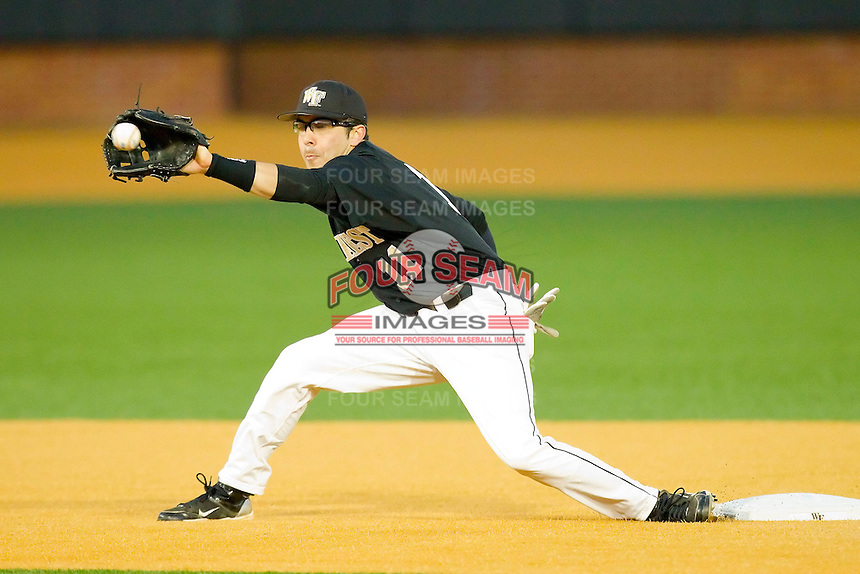 Shortstop Pat Blair #11 of the Wake Forest Demon Deacons waits for a throw at second base against the Western Carolina Catamounts at Gene Hooks Field on February 22, 2011 in Winston-Salem, North Carolina.  Photo by Brian Westerholt / Four Seam Images