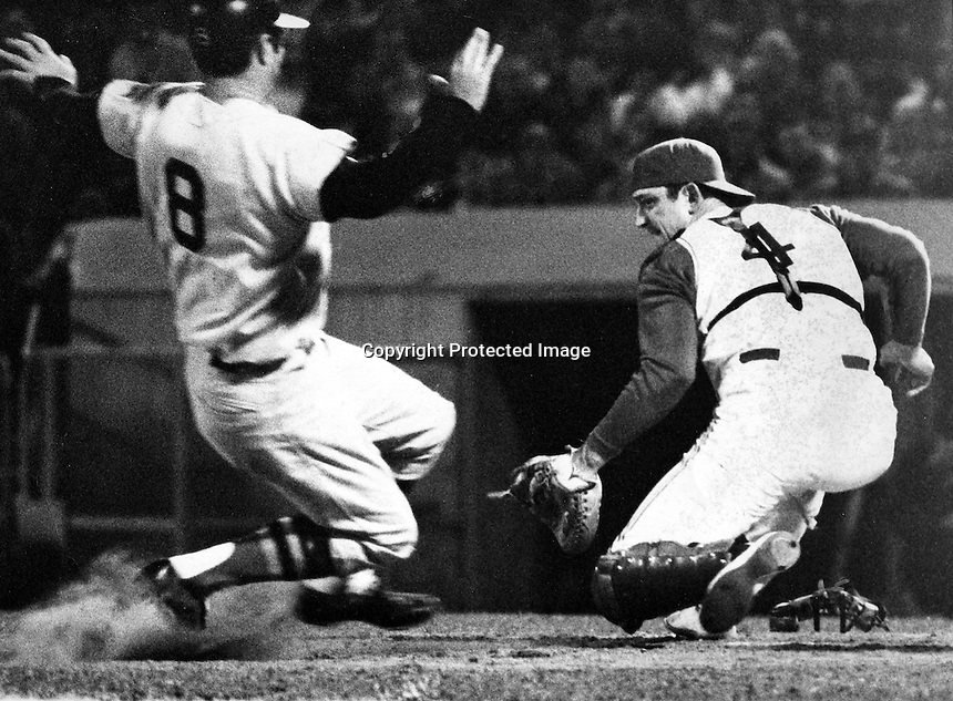 Oakland Athletics catcher Phil Roof wheels in time to tag out Boston Red Sox Carl Yastrzemski at the plate.<br />