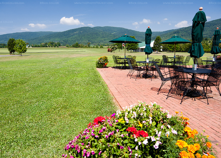 The terrace seating outside the tasting room at King Family Vineyards overlooks the horse stables and polo field.