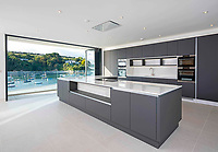 BNPS.co.uk (01202 558833)<br /> Pic: LillicrapChilcott/BNPS<br /> <br /> Sleek kitchen...<br /> <br /> A brand new futuristic property perched right on the edge of a sea wall overlooking some of the finest sailing waters in the country has gone up for sale for £4.5m.<br /> <br /> The ultra-modern home and just been built on remote headland in the Cornish sailing village of St Just.<br /> <br /> It replaced a large bungalow that stood on the coastal plot for over 80 years and was demolished by owner and architect Callum Wason.