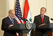 Washington, D.C. - June 24, 2005 -- United States President George W. Bush, right, and Prime Minister Ibrahim al-Jaafari of Iraq, left, hold a joint press conference in the East Room at the White House in Washington, D.C. on June 24, 2005.  They discussed the re-building of Iraq and refused to give a time-table for the withdrawal of United States forces.<br /> Credit: Ron Sachs / CNP