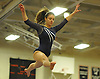 Jamie Simon of Plainview JFK performs on the balance beam during the Nassau County varsity gymnastics individual championships and state qualifiers at Hicksville High School on Tuesday, Feb. 9, 2016.