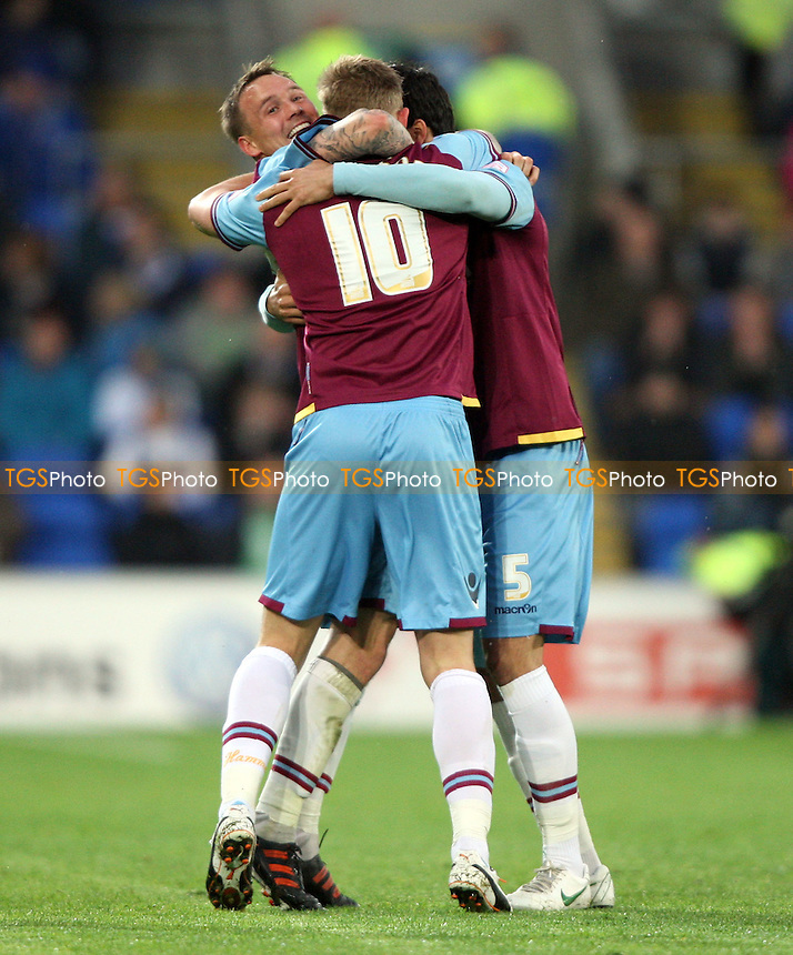 Jack Collison is congratulated by Matt Taylor and James Tomkins after scoring the 1st goal for West Ham - Cardiff City vs West Ham United, npower Championship Play-off Semi-Final 1st Leg at The Cardiff City Stadium, Cardiff - 03/05/12 - MANDATORY CREDIT: Rob Newell/TGSPHOTO - Self billing applies where appropriate - 0845 094 6026 - contact@tgsphoto.co.uk - NO UNPAID USE..