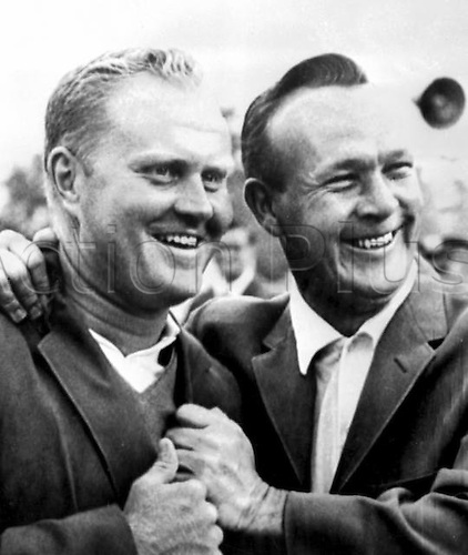 12.04.1965. Augusta, Georgia USA. Golfer Arnold Palmer (right), defending champion, helps the New Masters Champion Jack Nicklaus into his green coat, The traditional symbol of the Masters Golf Championship, here yesterday. Nicklaus won by nine trokes, setting a new course record of 271 for 72 holes. 12 April 1965