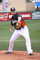 Miami Marlins pitcher Chad Qualls (50) warms up in the bullpen against the Houston Astros during a spring training game at the Roger Dean Complex in Jupiter, Florida on March 12, 2013. Houston defeated Miami 9-4. (Stacy Jo Grant/Four Seam Images)........