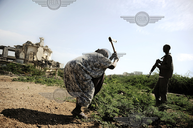 Mogadishu/Somalia 2012 - The woman cleaning up in the ruins of the city is part of the Mayor´s programs Food for Work.