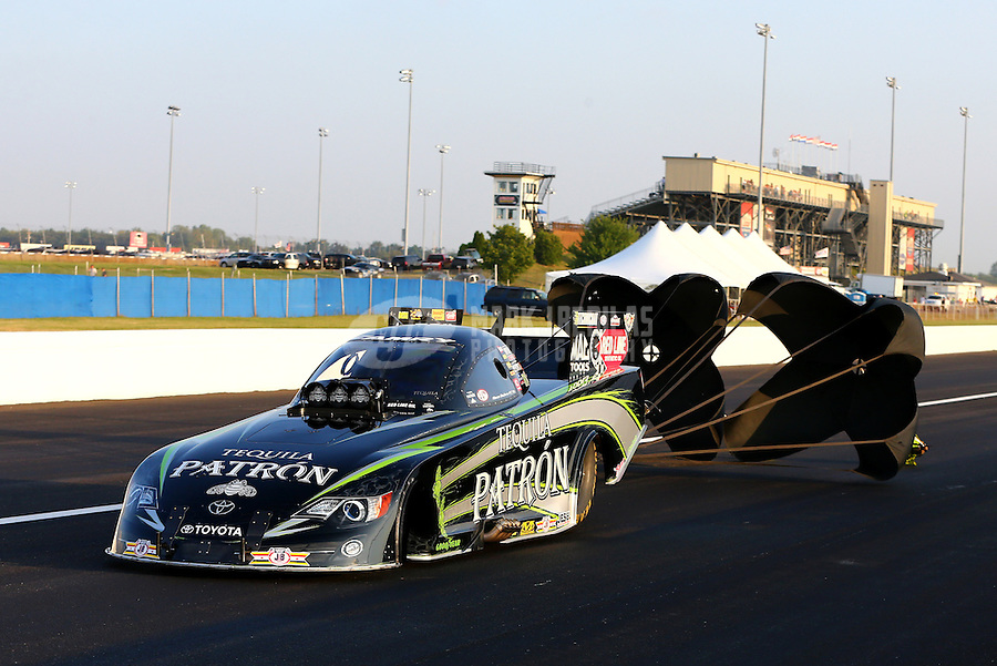 Aug. 30, 2013; Clermont, IN, USA: NHRA funny car driver Alexis DeJoria during qualifying for the US Nationals at Lucas Oil Raceway. Mandatory Credit: Mark J. Rebilas-