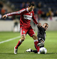 DC United midfielder Fred (7) slide tackles the ball away from Chicago Fire midfielder Marco Pappa (16).  The DC United defeated the Chicago Fire 1-0 at Toyota Park in Bridgeview, IL on August 29, 2009.