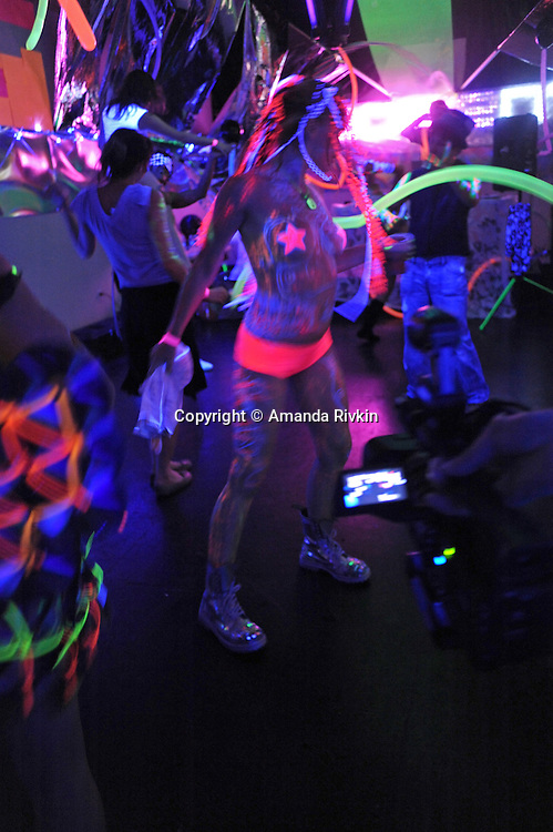 A barely covered woman dances at the Black and Light Ball on the Bowery in Lower Manhattan in New York, New York on May 9, 2009.