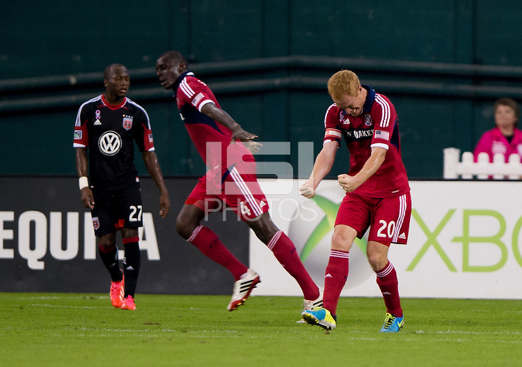 Jeff Larentowicz (20) of the Chicago Fire celebrates the goal of teammate Bakary Soumare (4) during a Major League Soccer game at RFK Stadium in Washington, DC.  The Chicago Fire defeated D.C. United, 3-0.