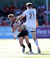 Ben Hellewell of London is held up by Thomas Minns during the Super 8 Qualifying game between London Broncos and Hull KR at Ealing Trailfinders, Ealing, on Sun Sept 11, 2016