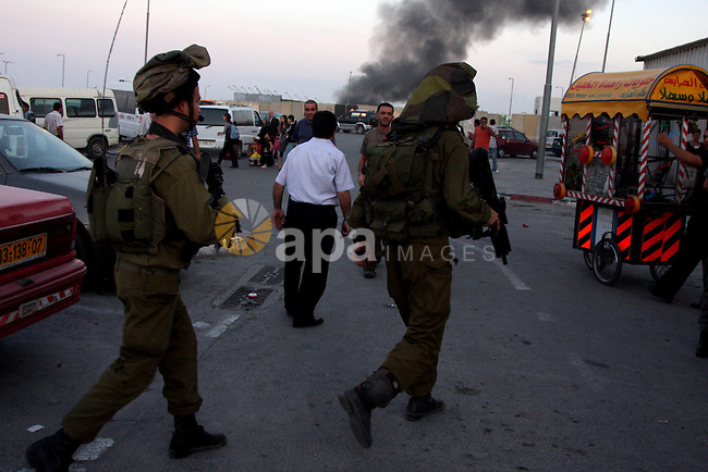 Israeli soldiers patrol the area outside the Israeli Qalandia checkpoint following a stabbing attack at the checkpoint, between Jerusalem and the West Bank city of Ramallah, Sunday, Oct. 25, 2009. by a Palestinian woman at the main checkpoint north of Jerusalem. The victim was a civilian guard working at the crossing, according to a spokesman for the border guard while an army spokeswoman said the attacker was a 20-year-old woman who stabbed the guard in the stomach before being apprehended. Photo by Issam Rimawi