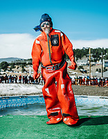 Robert Saluye dressed in protective cold water gear to help people after the polar plunge event during the 18th Annual Frozen Dead Guy Days in Nederland, Colorado, Saturday, March 9, 2019. The festival takes place in the Colorado mountain town of Nederland and features three days of festivities including live music, coffin racing, costumed polar plunging and more. The festival pays homage to Bredo Morstol, who is frozen in a state of suspended animation and housed in a Tuff Shed on dry ice high above Nederland. <br /> <br /> Photo by Matt Nager