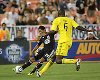 Andy Najar #14 of D.C. United sends a cross past Andy Iro #6 of the Columbus Crew during an MLS match at RFK Stadium on September 4 2010, in Washington DC. Columbus won 1-0.