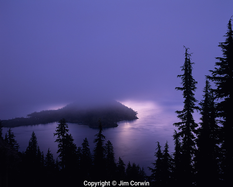 Crater Lake National Park Klamath County sunrise over Wizard Island in fog Crater Lake Central Oregon State USA