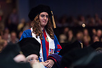 Holly Sanchez Perry stands to be recognized as a recipient of a Student Service Award during the DePaul University College of Law commencement ceremony, Sunday, May 14, 2017, at the Rosemont Theatre in Rosemont, IL, where some 240 students received their Juris Doctors or Master of Laws degrees. The Rev. Dennis H. Holtschneider, C.M., president of DePaul, conferred the degrees. (DePaul University/Jeff Carrion)
