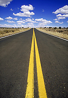 street level view of double yellow line on rural road. New Mexico.
