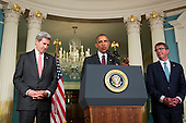 Flanked by United States Secretary of State John Kerry, left, and US Secretary of Defense Ashton Carter, right, US President Barack Obama makes a statement after meeting with his National Security Council at the State Department, February 25, 2016 in Washington, DC. The meeting focused on the situation with ISIS and Syria, along with other regional issues.<br /> Credit: Drew Angerer / Pool via CNP