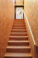 The internal walls of the house are made from OSB - Orientated Strand Board - which is constructed from compressed wood off cuts