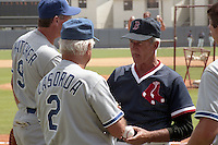 Boston Red Sox coach Johnny Pesky talks with Los Angeles Dodgers manager Tommy Lasorda during spring training circa 1989 at Chain of Lakes Park in Winter Haven, Florida.  (MJA/Four Seam Images)