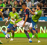 Seattle Sounders  (Brad Evans (3)defends New England Revolution  Juan Agundelo (17)during an MLS match on March 8, 2015 in Seattle, Washington.  The Sounders beat the Revolution 3-0.  Jim Bryant Photo. ©2015. All Rights Reserved.