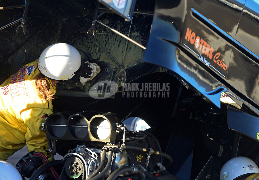 Nov. 10, 2012; Pomona, CA, USA: NHRA safety safari crew clean oil from inside the body on the car of funny car driver Josh Crawford during qualifying for the Auto Club Finals at at Auto Club Raceway at Pomona. Mandatory Credit: Mark J. Rebilas-