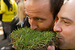In Dortmund fans celebrated a gigantic party because of the title win of their favorite soccer club BVB 09 in the German Premium League. Here  fans present and kiss their trophy, a piece of the turf.