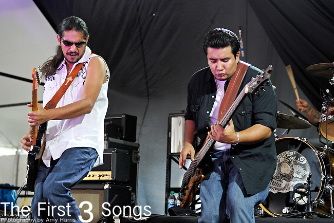 Henry Garza and Jojo Garza of Los Lonely Boys perform during Day 2 of the Orlando Calling music festival at Citrus Bowl Park in Orlando, Florida on November 13, 2011.