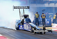 Sept. 21, 2013; Ennis, TX, USA: NHRA top fuel dragster driver Antron Brown during qualifying for the Fall Nationals at the Texas Motorplex. Mandatory Credit: Mark J. Rebilas-
