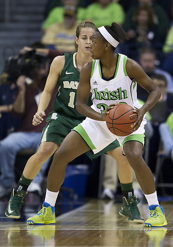 December 05, 2012:  Notre Dame guard Jewell Loyd (32) looks to pass the ball as Baylor guard Makenzie Robertson (14) defends during NCAA Women's Basketball game action between the Notre Dame Fighting Irish and the Baylor Bears at Purcell Pavilion at the Joyce Center in South Bend, Indiana.  Baylor defeated Notre Dame 73-61.