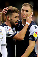 Millwall goalscorers Tom Bradshaw and Jed Wallace share a moment in the second half during Millwall vs Leeds United, Sky Bet EFL Championship Football at The Den on 5th October 2019
