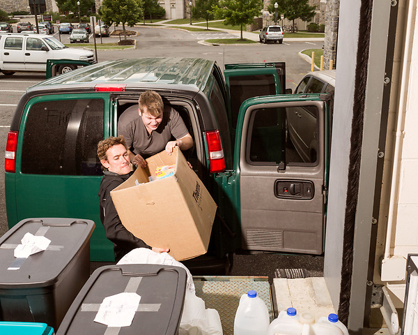 July 1, 2016. Blacksburg, Virginia. <br />  Marc Edwards helps unload a van just back from Flint, MI  on the loading dock of one of the Virginia Tech labs he oversees. The water testing team arrived back late the night before and must unpack all the supplies from the 2 week trip. <br /> Marc Edwards is a civil engineering/environmental engineer and the Charles P. Lunsford Professor of Civil and Environmental Engineering at Virginia Tech. He is an expert in water quality and corrosion, and his work in Washington DC  and in Flint, Michigan helped to expose high levels of lead contamination in the water supplies of those two cities, triggering investigations into the cause of the pollution.