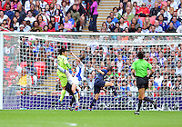 August 06, 2012..Japan's GK Miho Fukumoto repels an attack by France during Semi Final match at the Wembley Stadium on day ten in Wembley, England. Japan defeats France 2-1 to reach Women's Finals of the 2012 London Olympics.