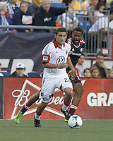 D.C. United defender Chris Korb (22) looks to pass as New England Revolution defender Andrew Farrell (2) defends. In a Major League Soccer (MLS) match, the New England Revolution (blue) tied D.C. United (white), 0-0, at Gillette Stadium on June 8, 2013.