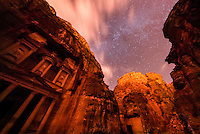 The Treasury, Petra Archaeological Park, with a starry sky overhead, Jordan.