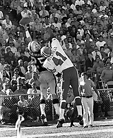 Oakland Raiders Fred Biletnikoff grabs one handed pass against Mitchell of the Denver Broncos..(1971 photo/Ron Riesterer)