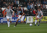 Ryan McGowan sandwiched between Lewis Guy and Paul McGowan in the St Mirren v Heart of Midlothian Clydesdale Bank Scottish Premier League match played at St Mirren Park, Paisley on 15.9.12.